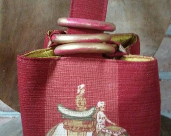 A Trio Bag worthy of a Maharani; Indian elephants marching around and below on soft red slubbed cotton with a gold red silk lining. Exotic!