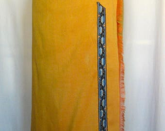 Chic sarong skirt in saffron yellow silk decorated angled art deco blue and yellow braid