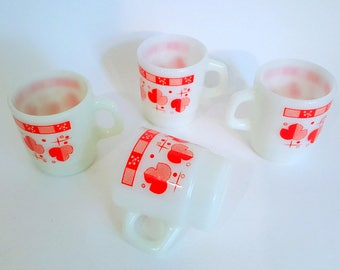 4 beautiful cups in milk glass with red  clubs pattern.