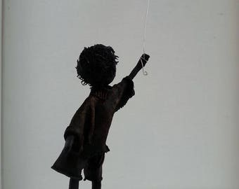Boy with Red Heart Shaped Balloon. Friendship sculpture. Available