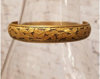 Gold tone on bronze leafy design bangle bracelet