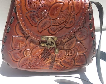 Large Mexican handcrafted leather purses. Awesome handtooled flowers, handstained brown color. Hand stitched durability.