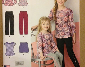 Simplicity 1334 Girls Peplum Top with Slim Pants or Mini Skirt - Size 7 8 10 12 14