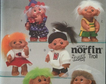 "Butterick 6439 Norfin Troll Family Clothing and Accessories Bride and Groom, Clown, Gym Clothes, Cheer - Size 10"" Doll"