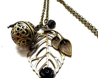 A scent! Necklace has perfume leaf, flower Black Pearl spun