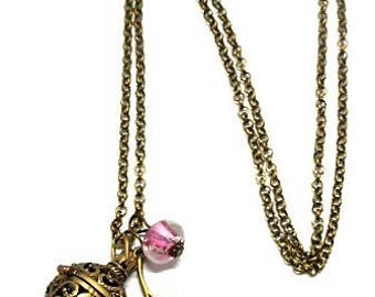 A scent! Necklace has perfume enameled flower, pink bead