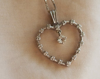 Elegant and timeless vintage 14K white gold heart pendant necklace set with Old European cut Diamond