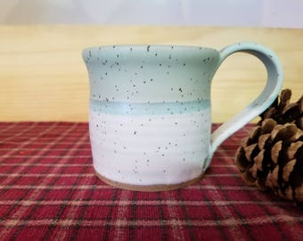 Icy turquoise and white pottery mug