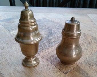 Vintage brass salt and pepper shakers. Vintage brass salt and paper shakers