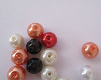 set of 17 synthetic pearls of various sizes and colors
