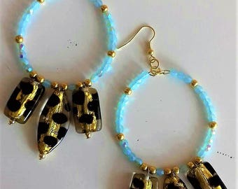 Rims with beads and glass pendants with gold leaf