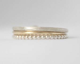 Set of 3 delicate stacking rings . 9k solid gold and 925 sterling silver bands . Simple, dainty stackable ring by SAMENA .