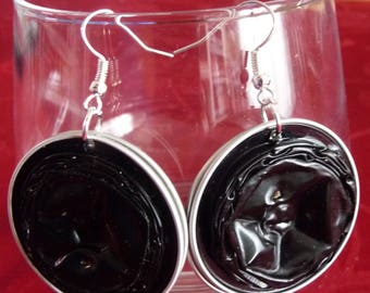 Beautiful earrings in black coffee capsules