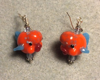 Orange and blue lampwork clownfish bead earrings adorned with light blue Czech glass beads.
