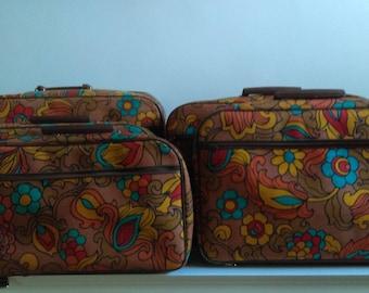Vintage Set of Five Nesting Floral Suitcases.