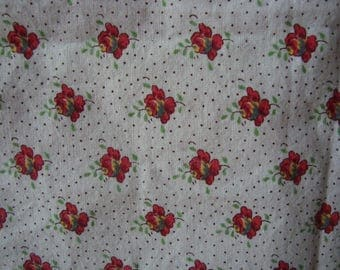 Fabric cotton provencal pattern has flowers and eyelets