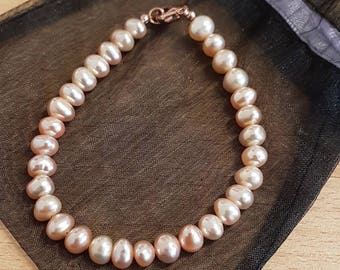 Peach freshwater pearl bracelet with rose gold plated 925 sterling silver bracelet.