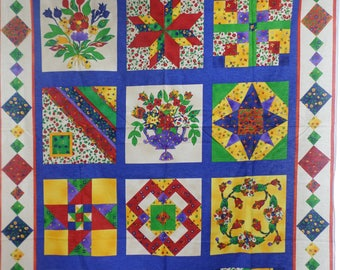 Quilting bee by fabriquilt to make a quilt  wallhanging or pillows or any thing you want 1 1/2 yards by 44 inches wide.
