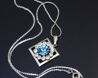 Vintage Necklace Fine Silver Tone Chain with Square Pendant Circle of Ice Rhinestones with Aquamarine Stone in Centre Openwork Design