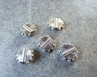 Set of 5 etched decorated silver metal beads