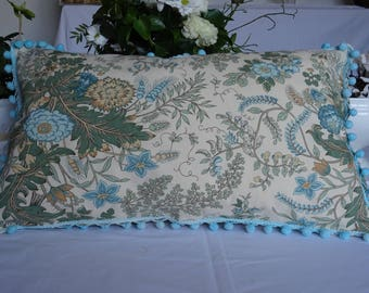 Pillow cover printed vintage 1970s in shades of blue green on a natural background
