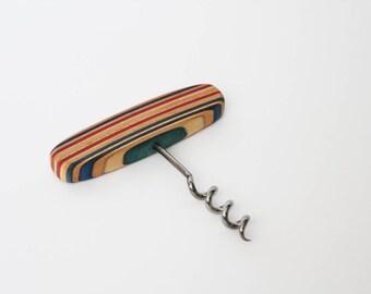 Corkscrew in recycled skateboard