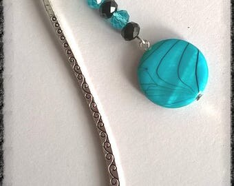 Label page consists of black and turquoise beads with a silver metal bead flat turquoise