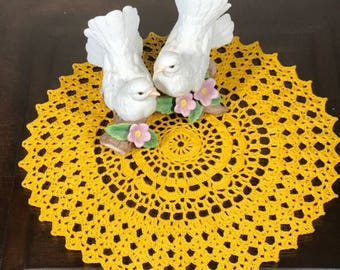 Golden yellow crochet doily