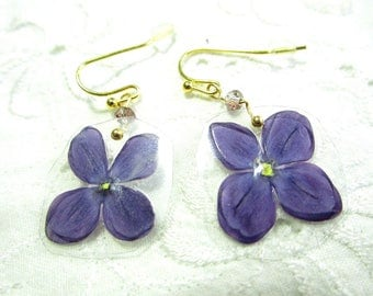 Very light weight earrings with real lilac, shimmering bead and gold coloured earhooks