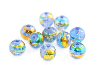 10 translucent blue, gold and blue glass beads 8mm