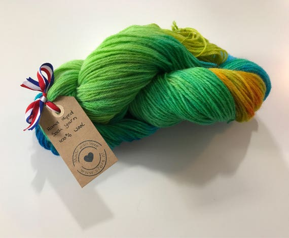 Hand dyed wool sock yarn in blue, yellow and green.