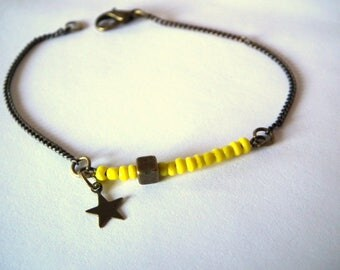 Yellow seed beads and bronze bracelet