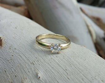 14K solid yellow gold and half carat diamond engagement ring