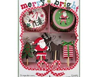 Meri Meri Christmas cupcake kit. Christmas cupcake topper. Christmas party decor. Christmas tableware. Christmas party. Santa toppers
