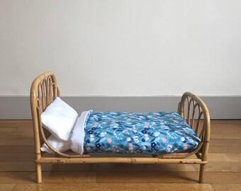 Vintage rattan doll bed
