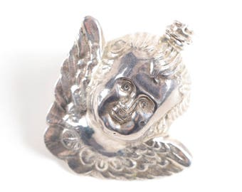 Sterling silver antique Victorian cherub-shaped perfume flask, late 19th century.