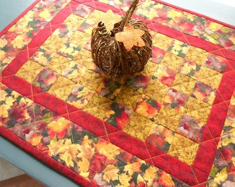 Fall Quilted Candle Mat/Small Wall Hanging with fall fabrics in golds, reds, orange colors