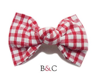 Hair bow tied red gingham.