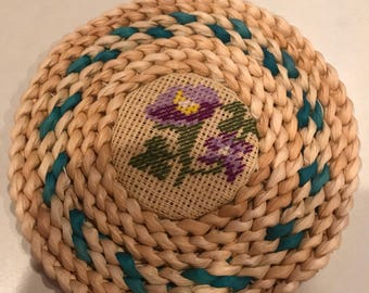 Six inch round cross stitch wicker hot pad