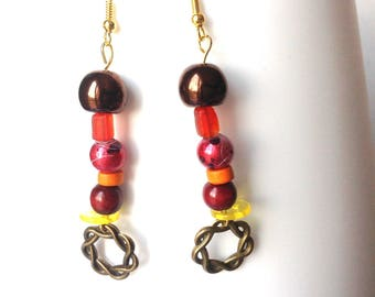 Earrings in the colors of citrus, orange, lemon, grapefruit,...