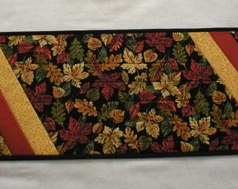 """Handmade Quilted Table Runner, with Fall Leaves on Black, with Rust and Dark Yellow Accents, About 13""""x48"""" (Runner2144-over40)"""