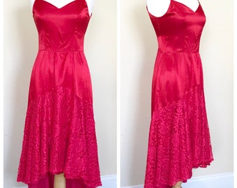 Red satin and lace dress. Fits a US women's size Small.