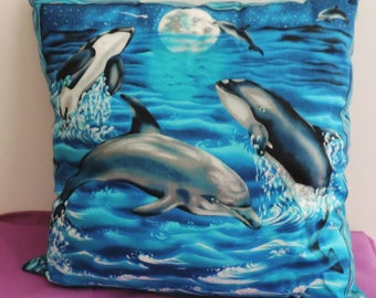 cushion has dolphins and Orcas pattern