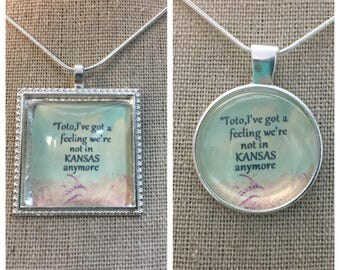 Toto,I've got a feeling we're not in Kansas anymore quote pendant necklace/keychain.Wizard of OZ quote pendant. Movie quote pendant.