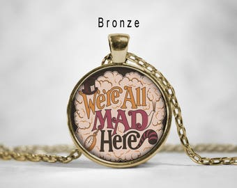 Alice in wonderland necklace,We're all mad here necklace, we're all mad here quote, alice in wonderland, we're all mad here pendant