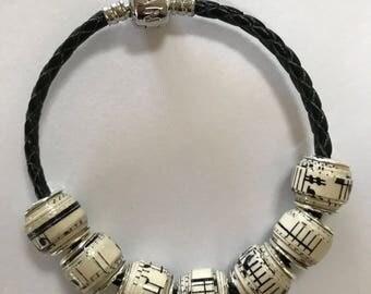 Paper bead bracelet featuring music
