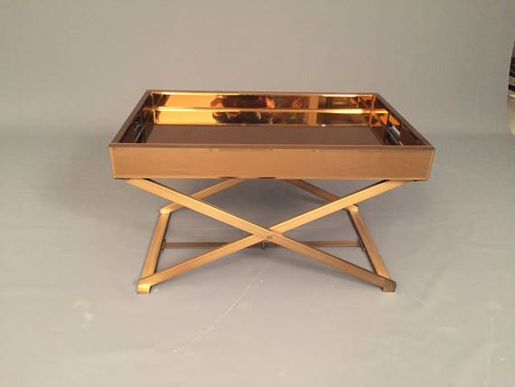Pre Owned Modern Mirror Glass Coffee Table on a metal stand.