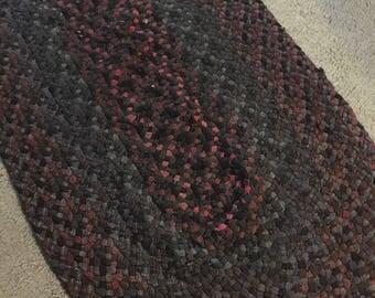Handmade reversible braided wool rug