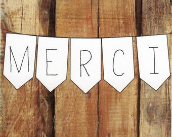 "Card ""MERCI"" simple, on wooden base."