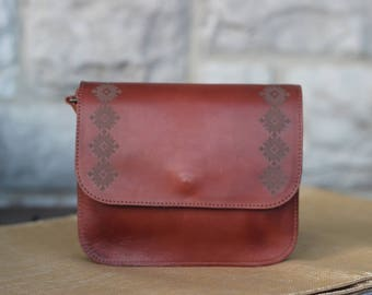 Small satchel with big laser-etched detail